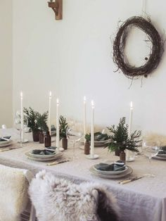 I recently shared my tips for simple Christmas entertaining and table styling for . Scandinavian inspired Christmas table setting with white candle sticks, linen table cloth and sheep skins on the chairs for added warmth Hygge Christmas, Nordic Christmas, Noel Christmas, Merry Little Christmas, Simple Christmas, Winter Christmas, Christmas Ideas, Christmas Wallpaper, Rustic Christmas