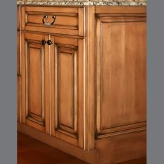 maple cabinets | Glazed maple cabinet with raised panel end
