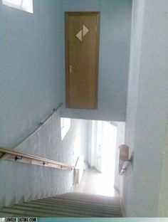 """Construction workers failed to install the """"Watch your step"""" sign on the door before finishing up the job."""