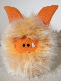 Creamsicle - a fun orange Fuzzling is ready for adoption