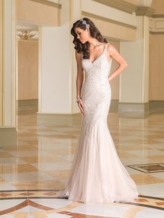 Justin Alexander Style Sophistication Is Embodied By This Tulle V Neck Fit And Flare Wedding Gown With An Empire Waist Strings Of Pearls Crystals Adorn