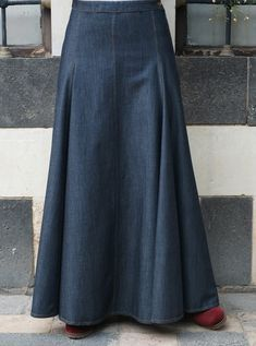 Upgrade your work wardrobe with the versatile Denim Professional Skirt. Tastefully cut for a sweeping and effortless look, this skirt is classy enough to be paired with your favorite blouses, and comfortable enough that you won't want to take it off. Long Denim Skirt Outfit, Denim Skirt Outfits, Maxi Outfits, Hijab Outfit, Modest Dresses, Modest Outfits, Versatile Denim, Long Maxi Skirts, Long Jean Skirts