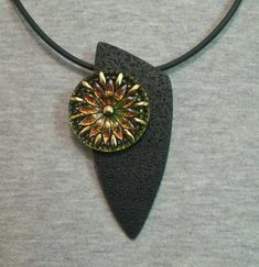 Polymer clay pendant with Czech glass button. Love the use of the button with the pendant.