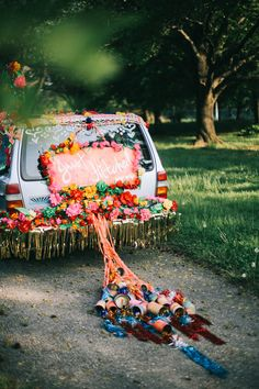 colorful bride + groom getaway car