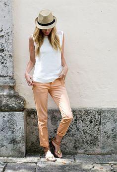 Shop this look on Lookastic: https://lookastic.com/women/looks/white-sleeveless-top-khaki-chinos-brown-thong-sandals-beige-hat/10820   — Beige Straw Hat  — White Sleeveless Top  — Khaki Chinos  — Brown Leather Thong Sandals