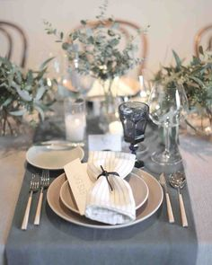 17 Creative Ways to Set Your Reception Table | Martha Stewart Weddings - To create a cohesive feeling, this bride set her table with monochromatic centerpieces, linens, and glassware. She added a subtle bit of texture with striped napkins from Restoration Hardware.