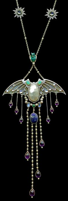 Symbolist Bat Pendant by Jugendstil, c.1907.  Silver, gold, opal, enamel, moonstone, pearl, amethyst lapis, turquoise, ruby & diamond.  German.