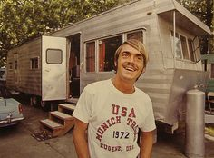 Awesome. Steve Prefontaine in front of his trailer in 1972.