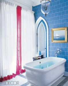 A bath in a vacation home in Vero Beach, Florida, designed by Robert Couturier, features a resin Paris tub by the Water Monopoly with wall-mounted Etoile fittings by Waterworks; the walls are sheathed with Metropol Glass tiles by Urban Archeology. Cheap Bathroom Tiles, Modern Bathroom Tile, Bathroom Tile Designs, Cheap Bathrooms, Simple Bathroom, Amazing Bathrooms, Bathroom Ideas, Bathroom Images, Blue Bathrooms