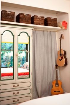 Shelf above with curtain,  a tension rod below between wall and dresser to hang clothes without a closet! Genius.
