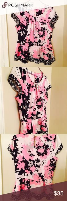 Cute floral pink, black, and white top! 😍❤️️😊 Cute floral top! Pink, black, and white! From New York and Company!!! Size Medium but also fits Small!! ❤️️😍👌 New York & Company Tops Tees - Short Sleeve