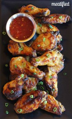 Paleo Glazed Chicken Wings from http://meatified.com. This glaze is fruit based, which means there are no added sweeteners! #paleo #whole30 ...
