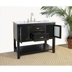 @Overstock - Update your bathroom decor with this elegant single-sink vanity. With an ebony finish and a granite top and sink, this vanity will give you storage space as well as a decorative touch for your master or guest bathroom. http://www.overstock.com/Home-Garden/Granite-Top-42-inch-Single-Sink-Bathroom-Vanity/5968971/product.html?CID=214117 $650.99