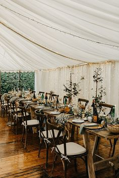 Garden-themed wedding reception with sage green and gold accents. Photo: @EmmaLawsonPhoto Home Wedding, Farm Wedding, Garden Wedding, Wedding Reception, Micro Farm, Marquee Wedding, Green And Gold, Table Settings, Tables