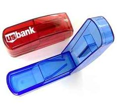 Travel pill box with cutter. Large size storage compartments for pills. Features a safe blade that accurately cuts pills to desired size. Great for medical offices and pharmacies to give to their new patients.