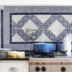 Blue-and-white backsplash tiles are timeless and classic. More tile backsplash ideas: http://www.bhg.com/kitchen/backsplash/behind-the-range-tile-backsplash/?socsrc=bhgpin071113blueandwhite=15