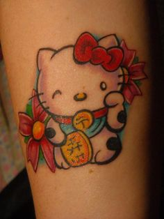 Hello kitty as a lucky cat! my first and only hello kitty tattoo. done by t.j @foolish pride tattoos. i am very in love with her.    - whiskeykittenn