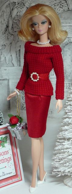 VISIT FOR MORE Sweater Girl Barbie Looks like someone from the reality show about housewives The post Sweater Girl Barbie Looks like someone from the reality show about housewiv appeared first on Fashion design. Red Sweater Outfit, Barbie Patterns, Doll Clothes Patterns, Christmas Barbie, Christmas Dresses, Barbie Dream, Girl Barbie, Vintage Barbie Dolls, Barbie Clothes