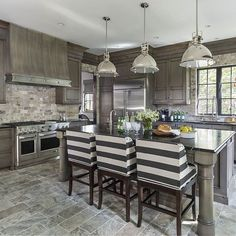 This #transitional #kitchen, designed by @hendelhomes feature #Italian #Limestone #floor #tiles and #backsplash, custom Alder cabinets and #soapstone #countertops. #Barstools are from #ballarddesigns. Make sure to see more of this home on the blog! #kitchens #interiordesign #homes #homeideas #frenchcountry #Frenchhome #transitionalinteriors