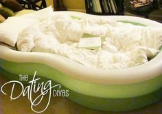 Use a kiddie swimming pool, fill with blankets and pillows and use for a night under the stars