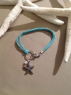 Qty 3 starfish charm bracelet on aqua cord