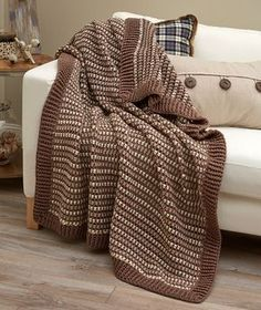 Lakehouse Throw, free pattern (LW5497) by Marianne Forrestal for Red Heart. Summer-weight throw, practically a mesh. Nice border, uses alternating FPDC & BPDC.  (Worked here in RHSS 'Mushroom', 'Aran', & 'Oatmeal') #crochet #afghan #blanket #edging