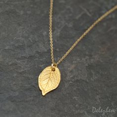 Dainty Gold Rose Leaf Charm Necklace by Delezhen. Minimalist Jewelry just got more darling for summer 2015. This necklace is perfect for layering with your other Delezhen Etsy Layer Necklaces!