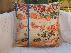 The pillow/cushion cover is made from Japanese Vintage fabric from the traditional embroidered Kimono OBI combination with smoky blue American modan fabric. The backing is ivory color with a zip hidden in the side. hapamood at etsy.