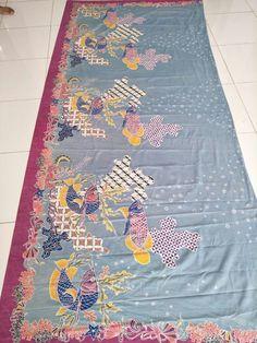 "Batik tulis ""arwana fish"""
