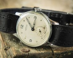 """This is a vintage watch by """"Pobeda"""" made in USSR. This watch is in a fully working order. Mechanical movement, manual winding, 15 jewels. Lovely rare"""