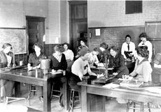 A group of women working on physics in the  physics laboratory. Text on back of photograph:  'Laboratory work - women', 1900-09