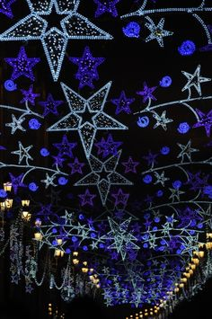 Christmas lights in Sevilla-- do this on the roof of the porch