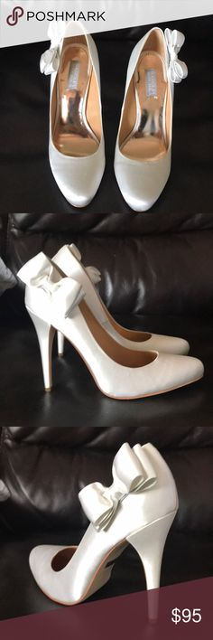 Badgley Mischka White Satin Calton heels Badgley Mischka Calton white satin 4in heel, never worn(only tried on a couple times), were going to be my wedding shoes but I went with red 😍. Still in box and has shoe bag included! Badgley Mischka Shoes Heels