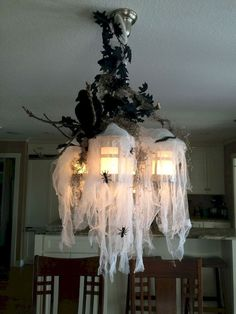 Astonishing DIY Dollar Store Halloween Decoration Ideas - No contest, hands down. Halloween is my favorite holiday! In addition to planning our Film Society's annual Halloween event, I also spend hours onli. Dulceros Halloween, Table Halloween, Dollar Store Halloween, Halloween Home Decor, Halloween Birthday, Diy Halloween Decorations, Holidays Halloween, Halloween Lighting, Halloween Chandelier