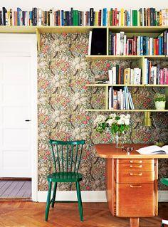 bookshelves and desk against wallpaper