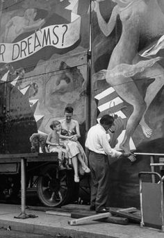"""I LOVE this idea, wish I could have gone in- Original caption in LIFE: """"Gypsy's husband Julio ... paints the entrance while Gypsy and son watch. His attraction [in the carnival] is called Dream Show."""""""