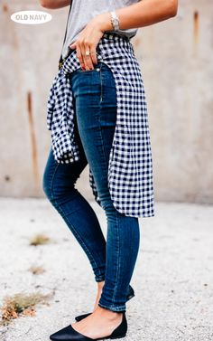 How to do the '90s without going full-on: tie a plaid shirt tied around your waist and  add a pair of classic black flats.