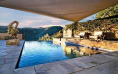 this salt water infinity pool seems to vanish into the horizon amidst surrounding mountains and canyons. Horizon Pools, My Dream Home, Dream Homes, Property Design, Pacific Palisades, Outside Living, Real Estate News, Living Styles, Salt And Water