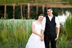 Cute groom in black vest and white shirt :)