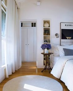 Love the calm of this bedroom -- the home of Remodelista editor Julie.  Such lovely colors! (pink-hued white, cream, grey, violet, matte black, warm wood)