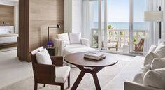 A standard guest room in the Miami Beach Edition Hotel, which features cerused oak walls, white porcelain floors, natural woven mats, and soft billowy drapes. Top Interior Designers, Best Interior Design, Luxury Interior, Miami Beach Edition, Edition Hotel, Miami Beach Hotels, Yabu Pushelberg, Hotel Room Design, Inspiration Design