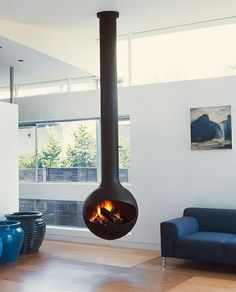 What is better than a hanging fireplace? A hanging fireplace that is also capable of rotating! Check out this design from Focus Creations:
