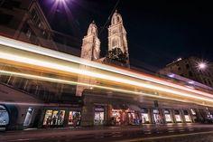 Grossmuenster church at night with light trails left by a tram, Zurich, Switzerland. Light Trails, Switzerland, Night