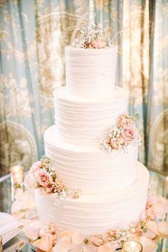 Pretty pink petal accented wedding cake via Kay English / http://www.deerpearlflowers.com/amazing-wedding-cake-ideas/ #weddingideas