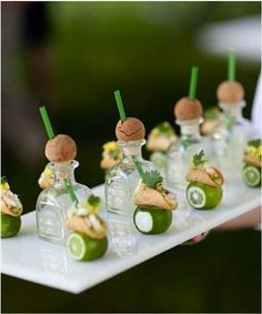 The other night I was at a cocktail party and these teeny-tiny sips of a margarita were served right out of a miniature Patron bottle. Nest...
