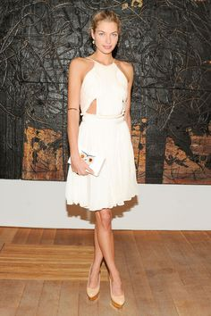 Jessica Hart works the LWD with panache. Pulled back hair and cut-outs lends a fresh vibe.