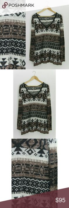 """🌙Free People Tribal Print Sweater🌙 Beautiful fuzzy and soft tribal print long sleeve sweater from Free People. Oversized and flowy. Super comfy and warm. Perfect for fall/winter.   Size: Tag says XS but could fit a Small since it is oversized. Please check measurements just to be safe! Brand: Free People Material: Wool, Acrylic, Cotton, Nylon, Rayon, Polyester Condition: Great! ~MEASUREMENTS~  (taken laying flat)  Length: 30"""" Chest: (underarm to underarm) stretches to 22""""  Tags: boho…"""