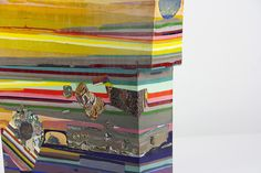 Self-taught artistLaura Moriarty's sculptural paintings appear like long lost geodes, geological mysteries layered with multi-colored rings. The asymmetrical pieces reference the earth not only in their appearance but also their process, as Moriarty heats and cools pigmented beeswax is a way th