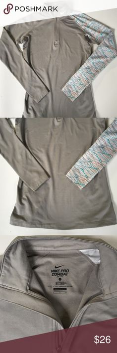 EUC Nike top Excellent condition- worn once. Long sleeve, Nike Pro Combat Dri-Fit. Fitted styling; polyester/spandex; thumb holes on sleeves. Smoke-free/pet-free home. Nike Tops