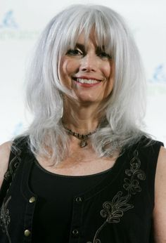 Emmylou Harris shows off her gorgeous, well-maintained grey hair with bounce and volume.